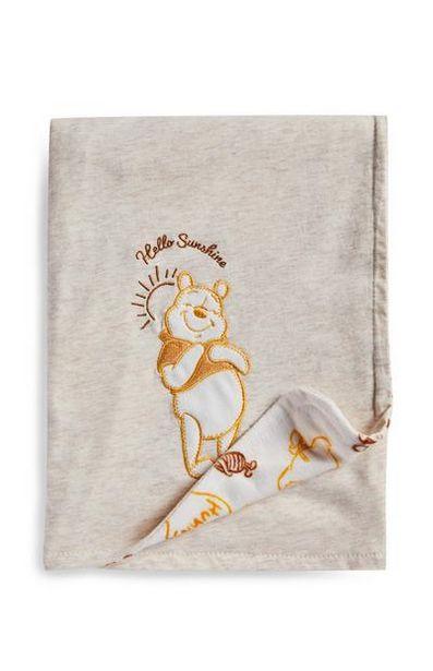 Aanbieding van Grijze deken Winnie de Poeh voor 8€